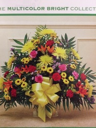 Multi-color funeral basket from Philips' Flower & Gift Shop
